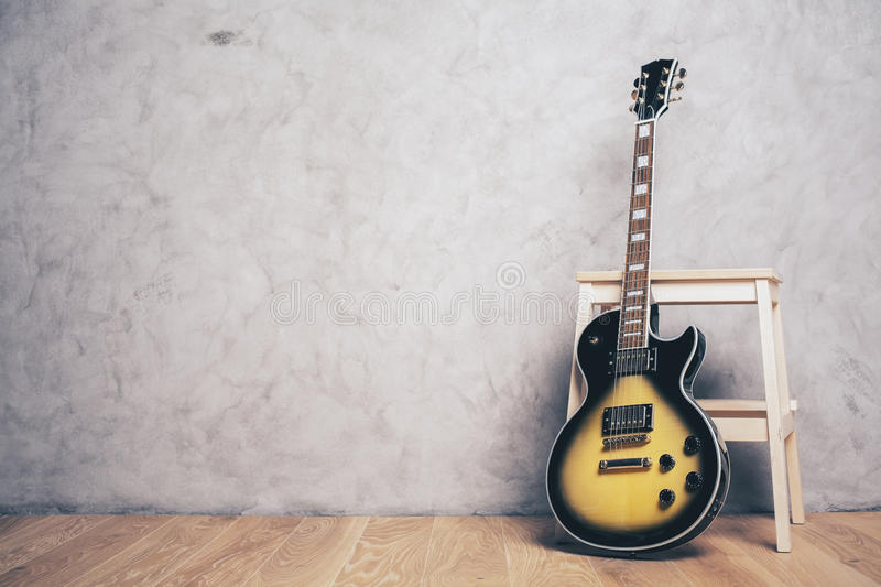 Electric guitar and stool royalty free stock image