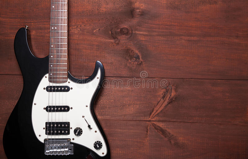 Electric guitar on the table. Electric guitar on the wooden table royalty free stock image