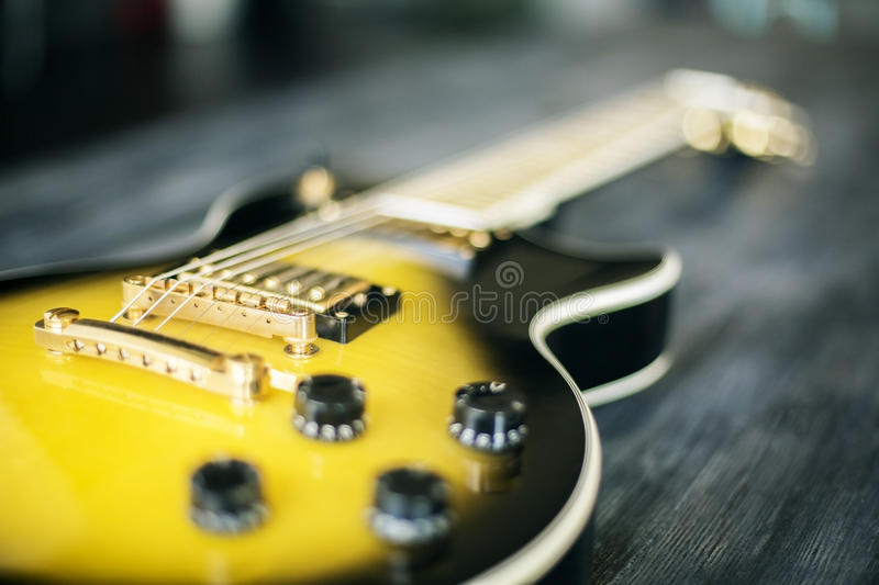 Electric guitar on wooden desktop royalty free stock image