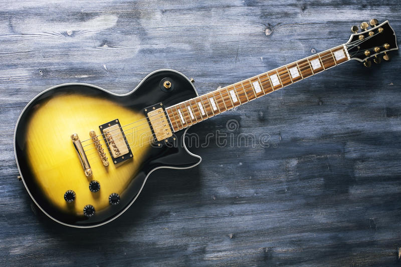 Electric guitar on wooden surface royalty free stock photo