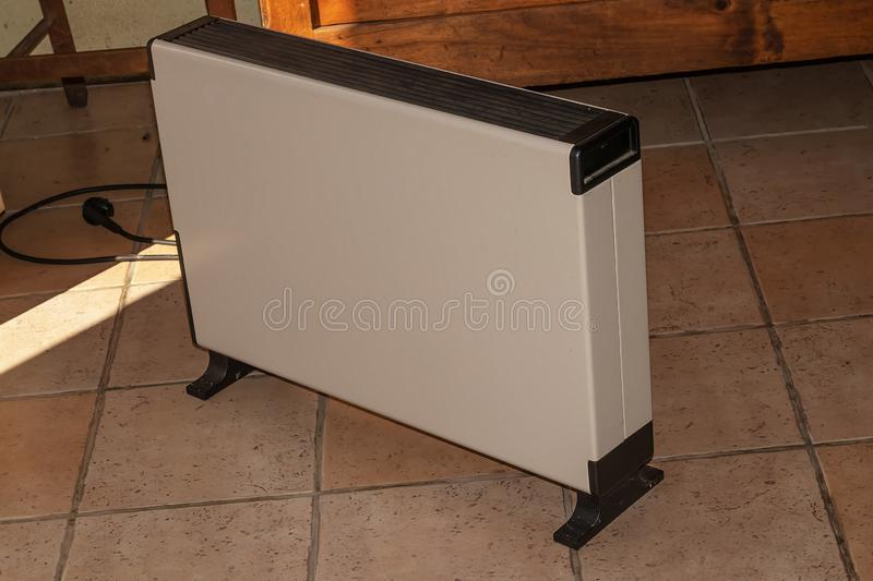 Electric heater on the stone floor of the old house stock images