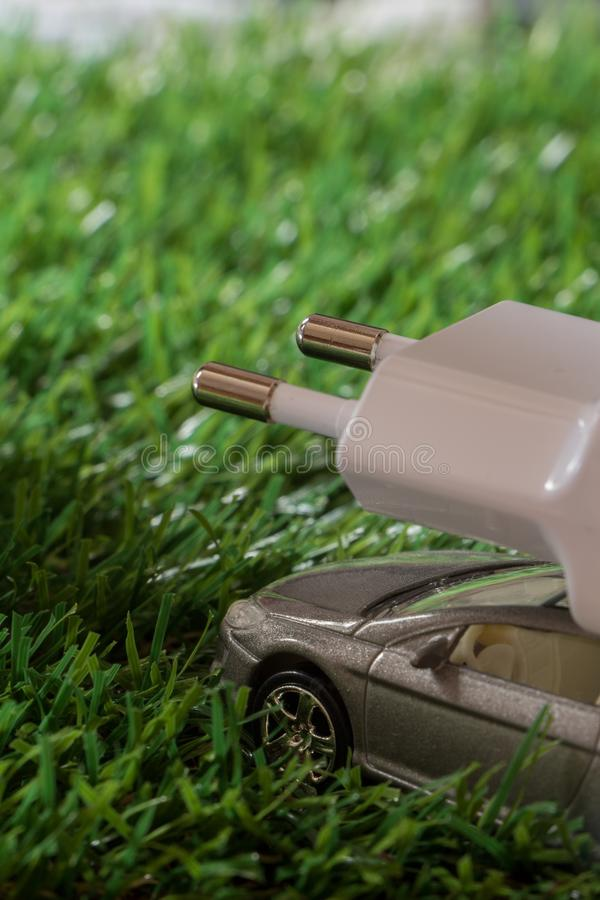 Electric / Hybrid car concept, on green grass royalty free stock photo