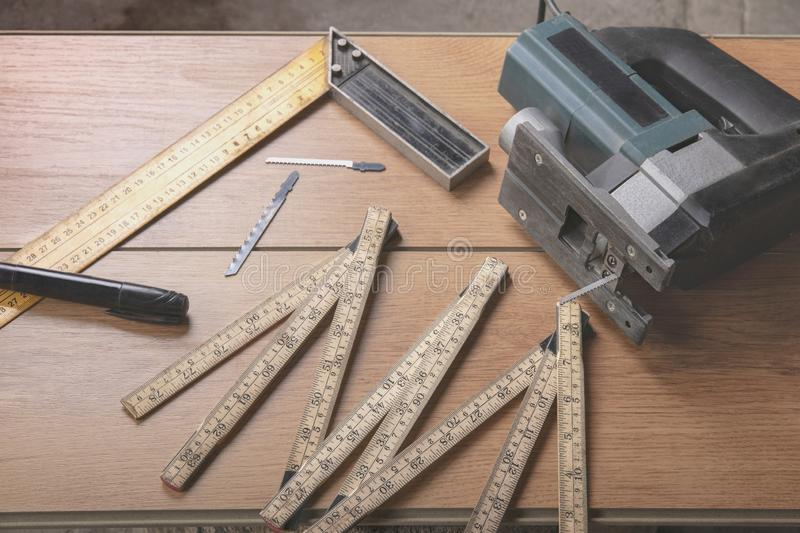 Electric jigsaw and carpenter tools in workshop royalty free stock photo