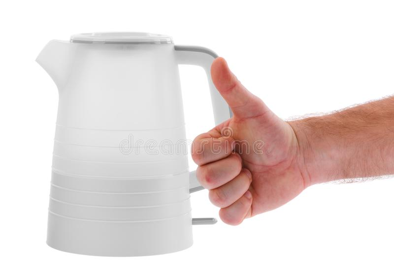 Electric kettle isolated on white background. And man hand show that this is good kettle stock images