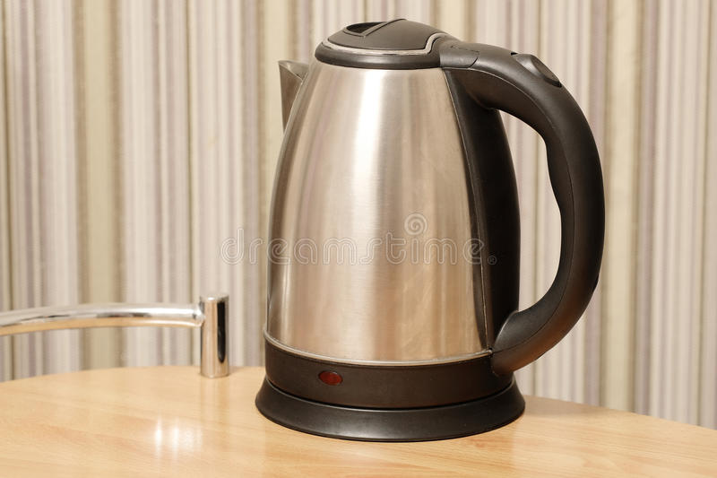 Electric kettle. On a table stock photo