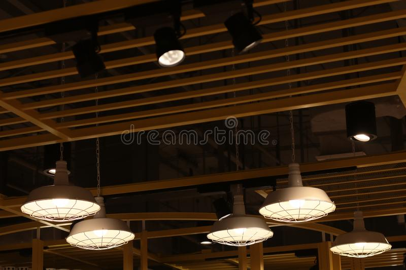 A electric lamp lighting . modern and vintage style , interior ceiling hanging light bulb decorate at room stock images