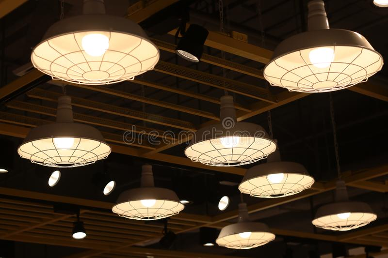 A electric lamp lighting . modern and vintage style , interior ceiling hanging light bulb decorate at room stock image