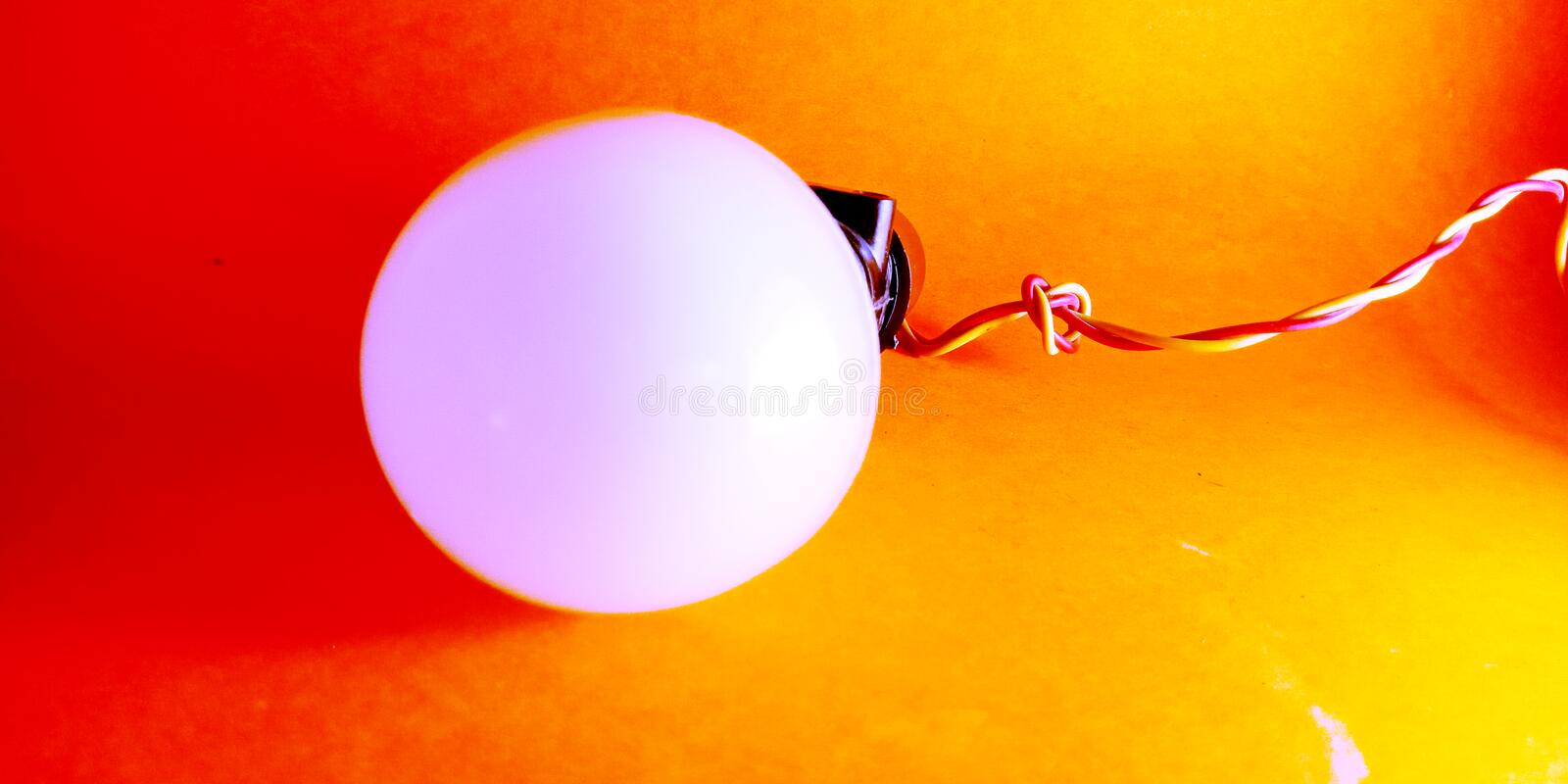 electric led bulb with wire and black holder stock photo royalty free stock photo
