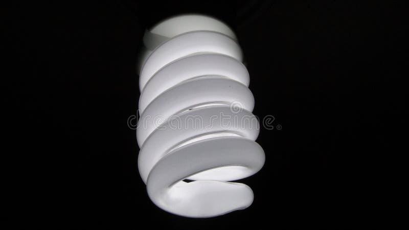 Electric light bulb on black royalty free stock photo