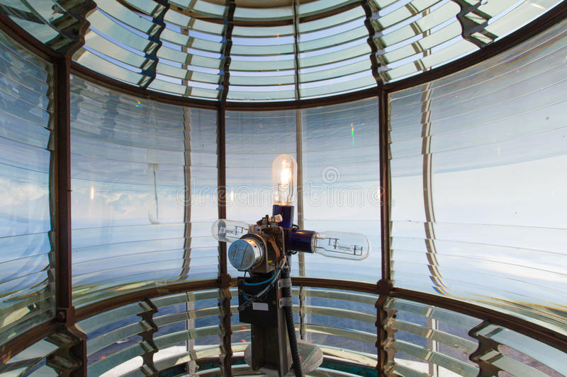 Electric light bulb of Lanse Amour Lighthouse NL. Electric light bulb assembly and glass fresnel lens of L`anse Amour Lighthouse at Strait of Belle Isle stock image