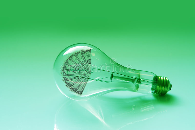 Electric Light Bulb and Money royalty free stock images
