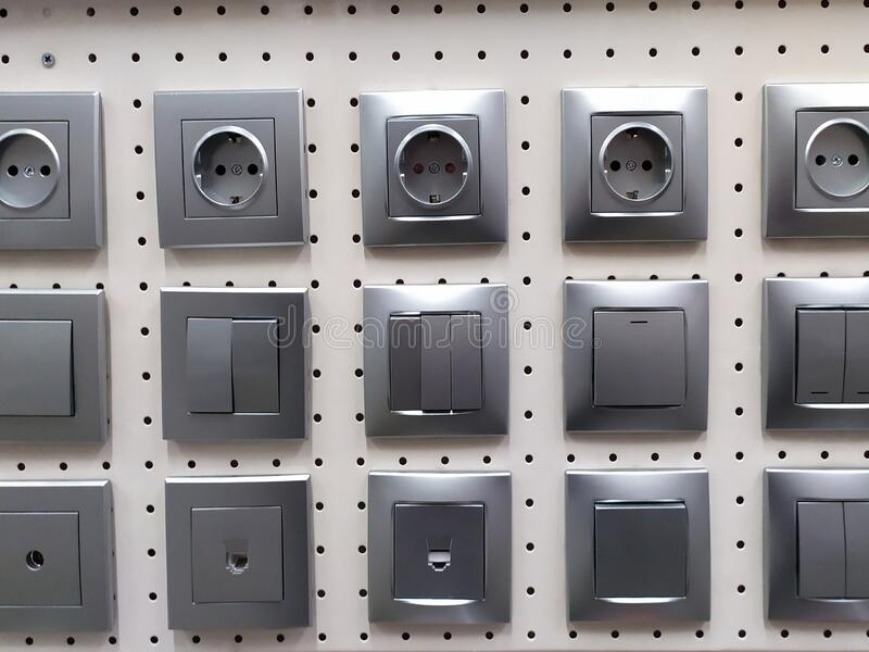 Electric light switch and socket displayed in a shop. Electric sockets and light switchers display in construction home decor shop royalty free stock image