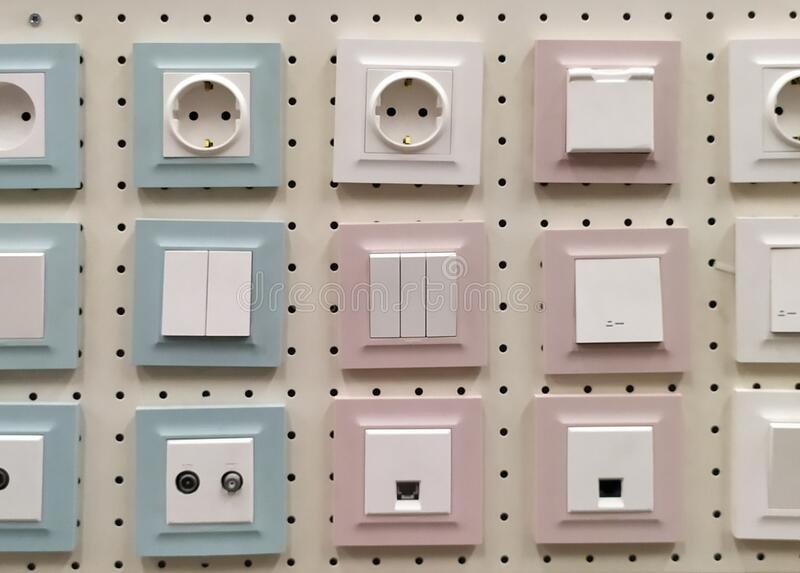 Electric light switch and socket displayed in a shop. Electric sockets and light switchers display in construction home decor shop stock images