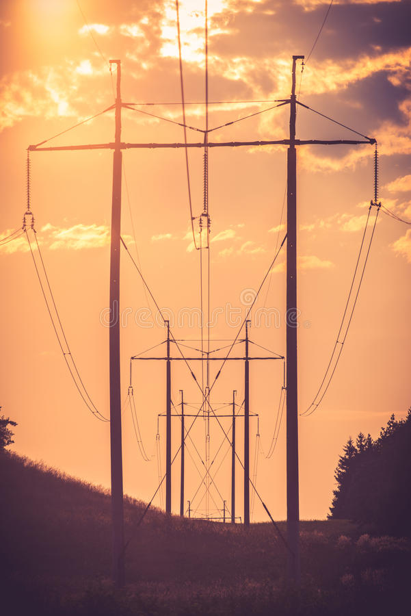 Electric line. Over the cloudy sunset sky royalty free stock photography