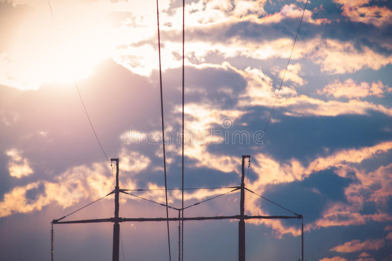 Electric line. Over the cloudy sunset sky royalty free stock photo