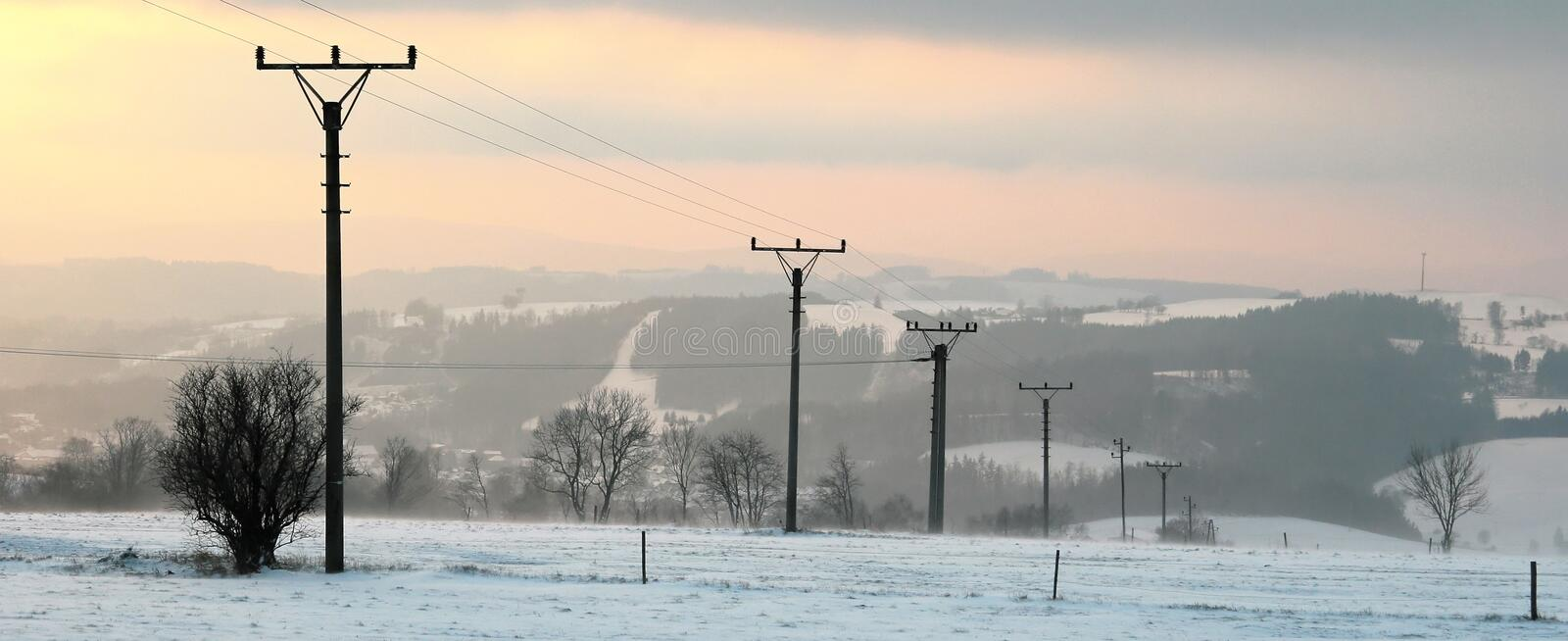 Electric line in the winter. Electric line on the snow-covered hill royalty free stock photography