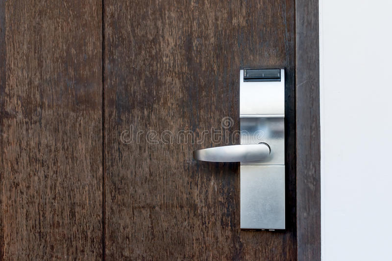 Electric lock on a wooden door stock photos