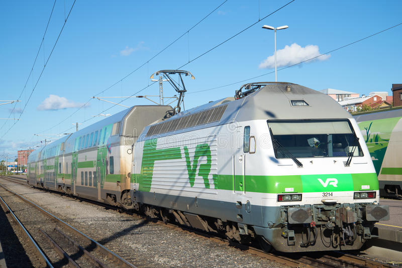 Electric locomotive Sr2 with two-story passenger cars at the railway station. Finland. TURKU, FINLAND - AUGUST 27, 2016: Electric locomotive Sr2 with two-story stock photos