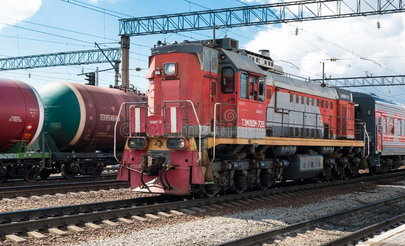 Electric locomotive with wagons at the city station. Front view royalty free stock images