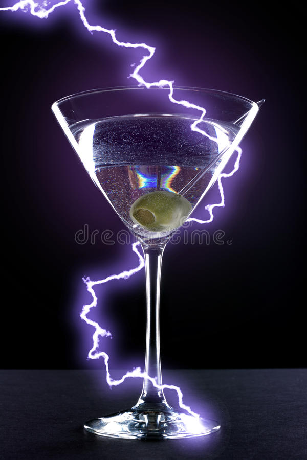 Electric Martini. Martini with Green Olive with Purple Lightning Bolt stock photography