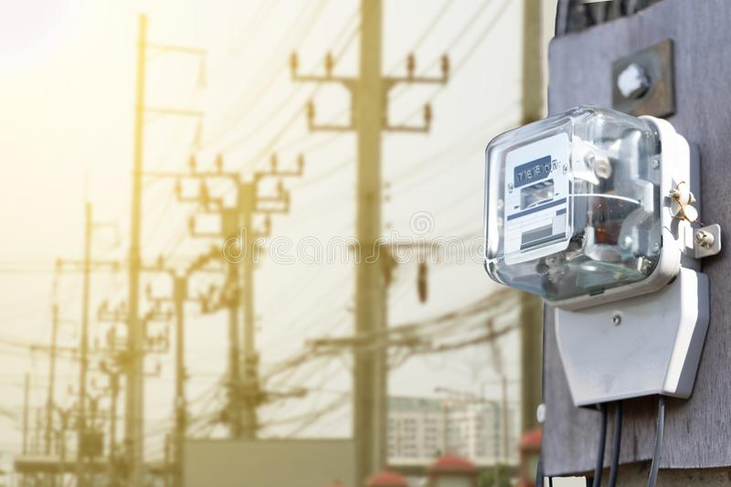 Electric meter on electric pole background sunset. stock photos