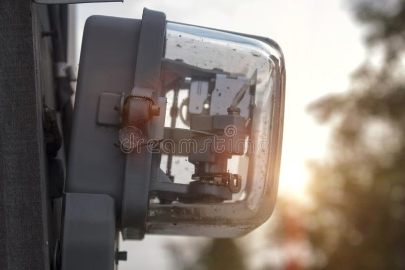Electric meter installed on the pole stock image