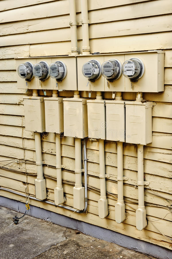 Electric Meters On Side of Old House Converted to Apartments royalty free stock image