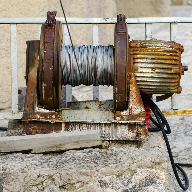 Electric motor with belt drive gear for winding steel wire royalty free stock image