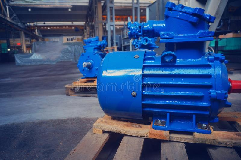 The electric motor is new, blue in stock on the rack royalty free stock photography