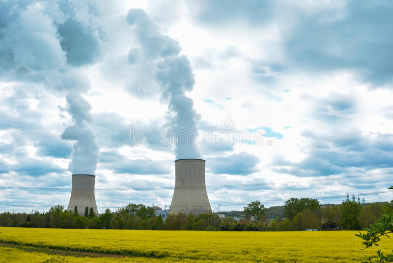Electric and nuclear power. With yellow field royalty free stock photos