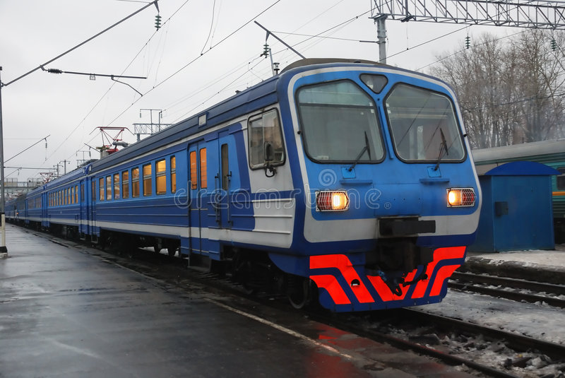 Electric passenger train. In the station in winter stock photography