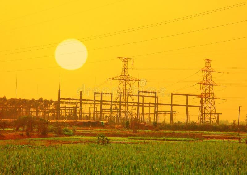 Electric pillar in sunset stock image