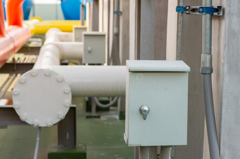 Electric pipe and control box. Electricity control box on factory.  royalty free stock photo