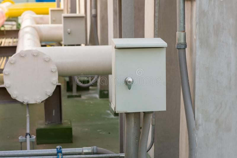 Electric pipe and control box. Electricity control box on factory.  royalty free stock image
