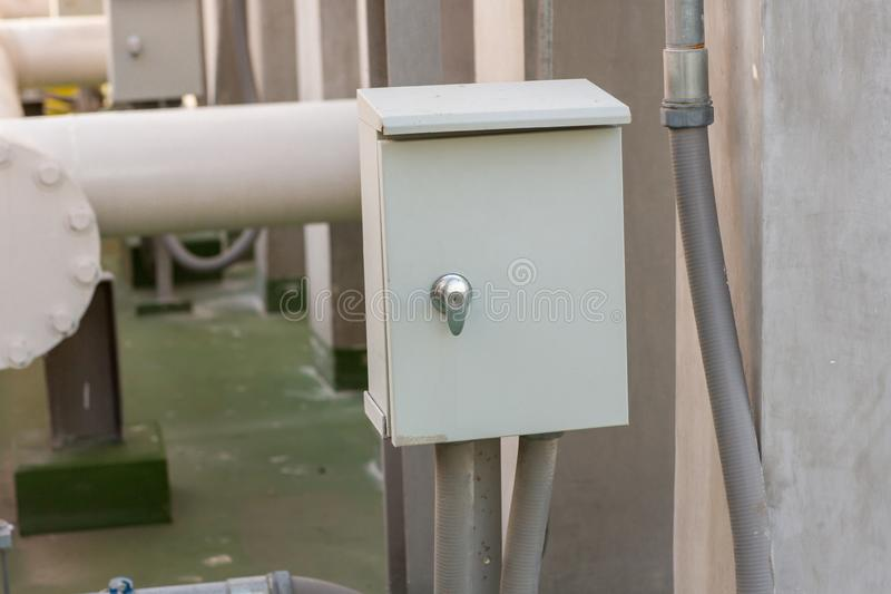 Electric pipe and control box. Electricity control box on factory.  stock photography