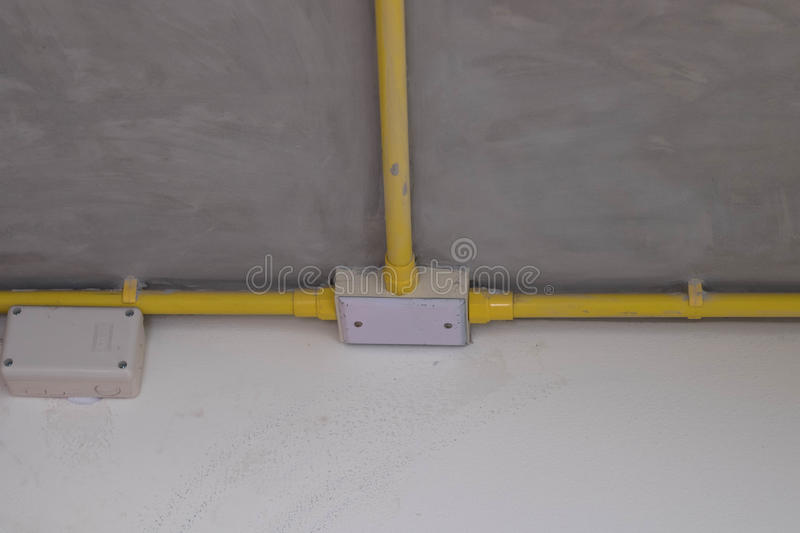 Electric pipe line on celling stock photo