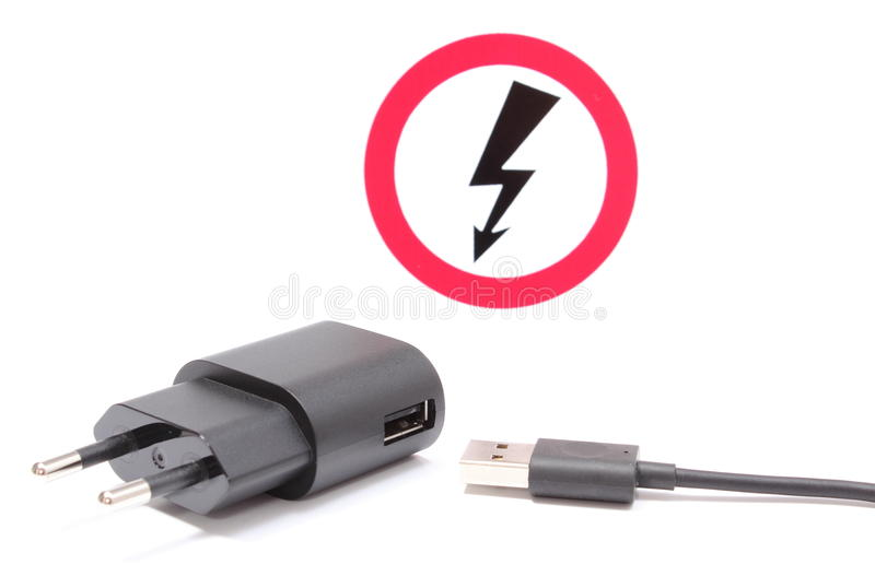 High Voltage Electrical Cable : Electric plug and cable with high voltage danger sign