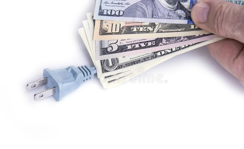 Electric plug with dollar money on the white. Energy save concept. Electric plug with dollar money on the white. Energy save concept stock photos