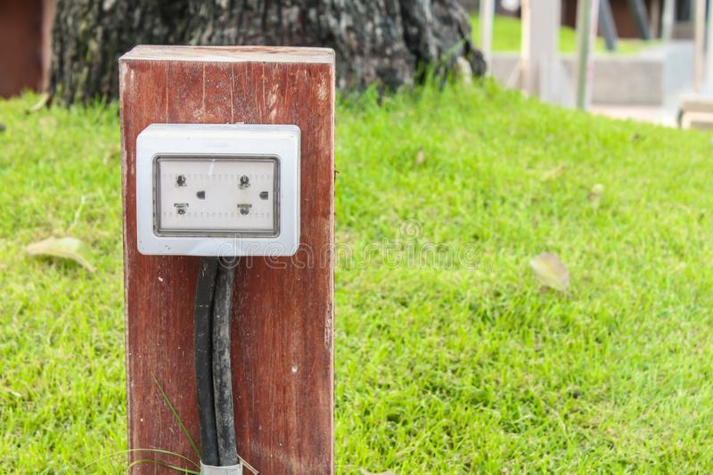 Electric plug in the garden royalty free stock photo