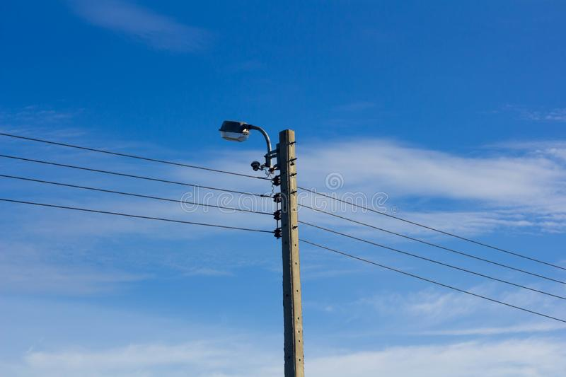 Electric pole according to the country stock photography