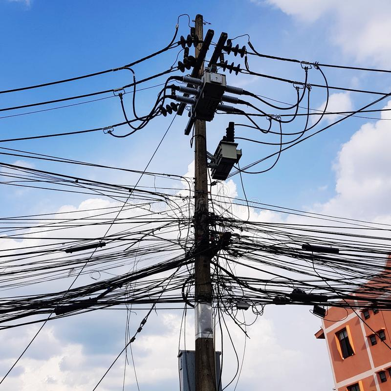 Electric pole and cables in Thailand. Town, city, technology, wire, power, grid, supply, voltage, electricity, communication, transmission, network, line stock image