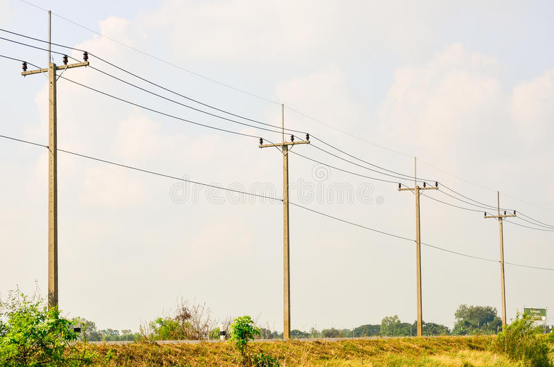 Electric pole on a country road stock photography