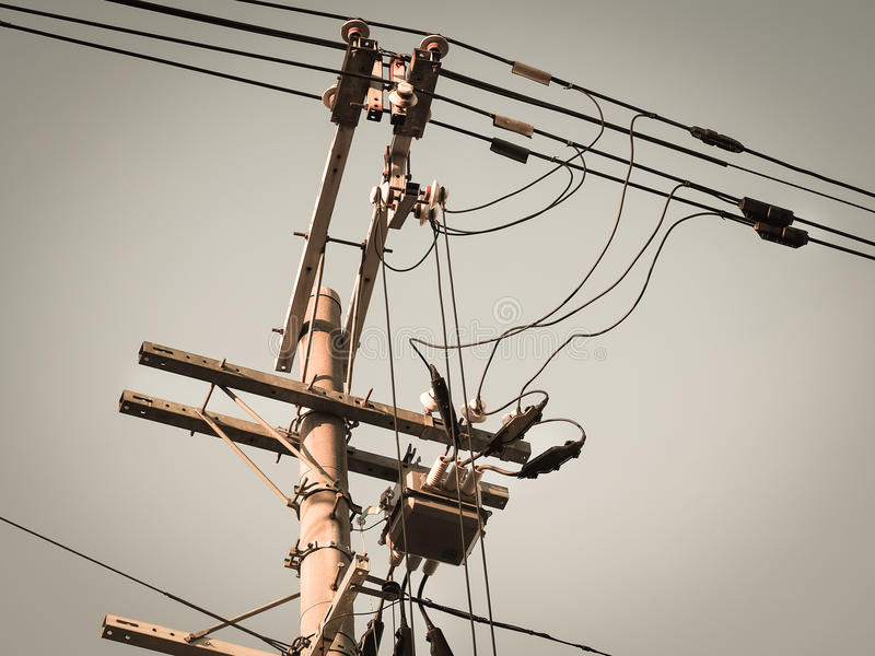 Electric pole with electric transformers and electrical cables stock images