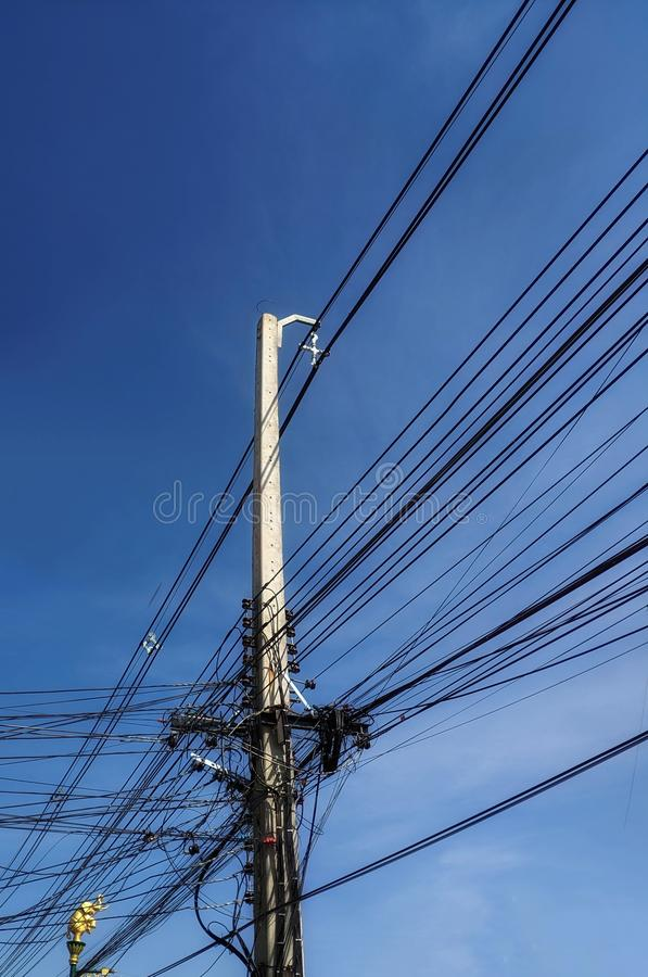 Electric pole and electric wire line background blue sky royalty free stock images