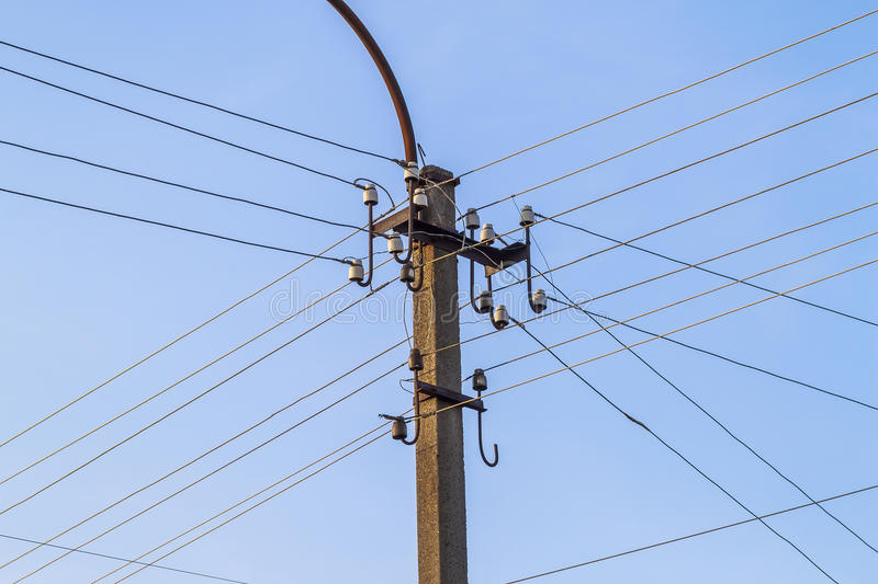 Electric pole power lines and wires with blue sky royalty free stock photography