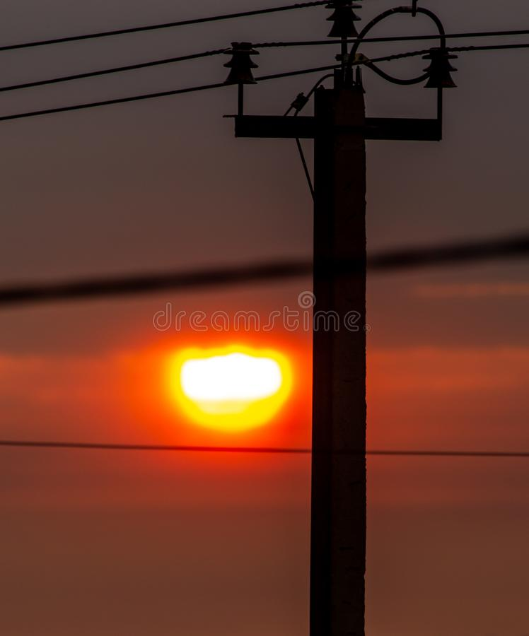 Electric pole at sunset as background stock photos
