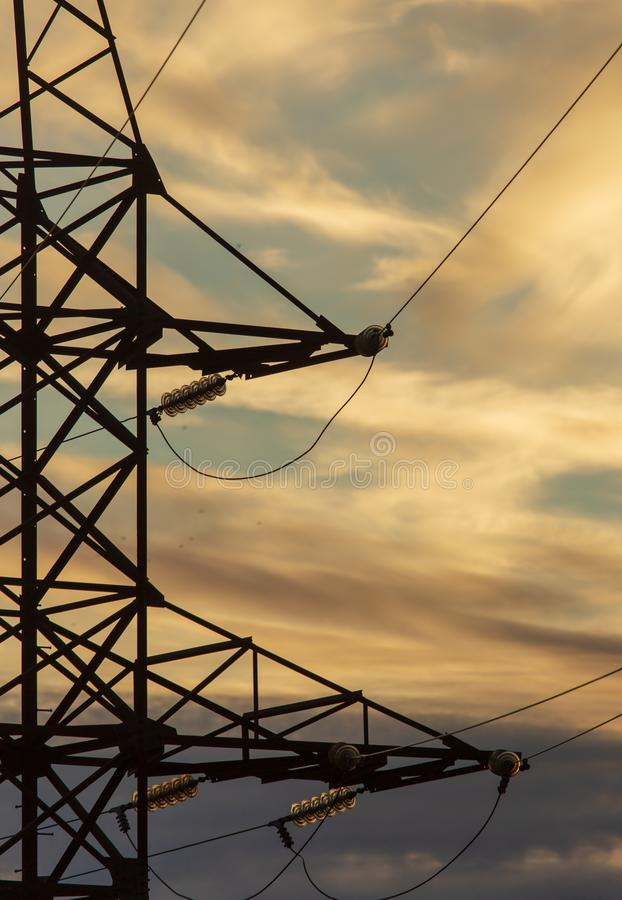 Electric pole at sunset as background royalty free stock photos
