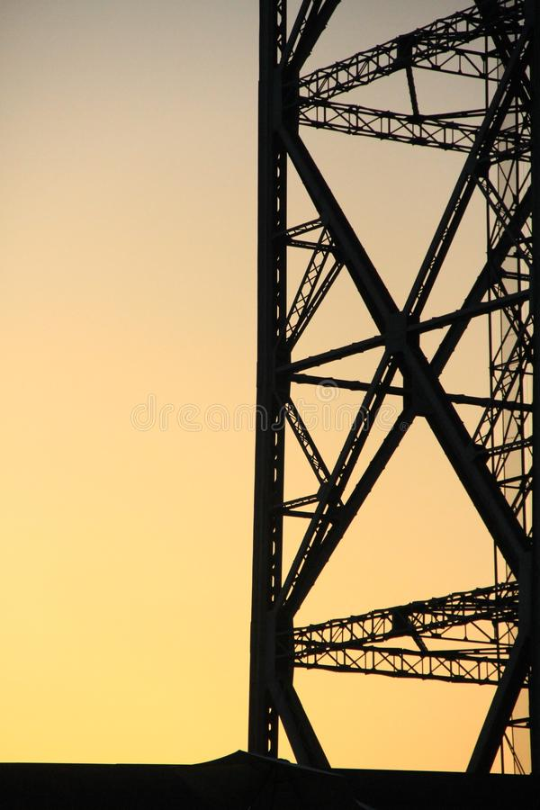 Electric pole at sunset stock image