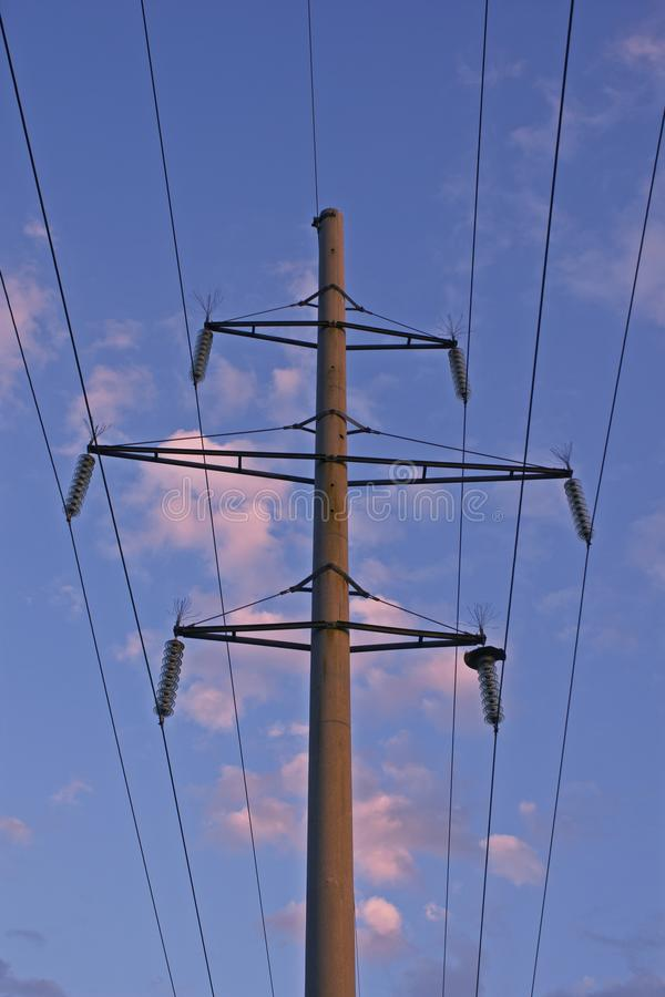 Electric pole wire sky. High voltage electric poles power lines royalty free stock images