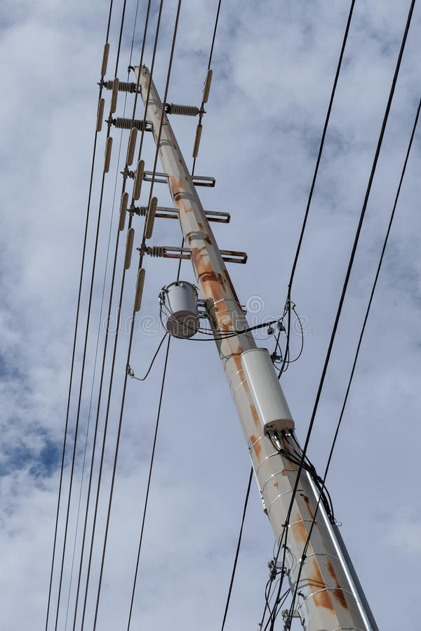 Electric pole and wires. High Voltage Electric Pole and wires,transformer and transmitter royalty free stock image
